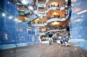 Action from the 2011 European Individual Championships taking place on the all-glass showcourt erected in the Blue City shopping centre in Warsaw. Photograph courtesy of Pawel Dziurzynski