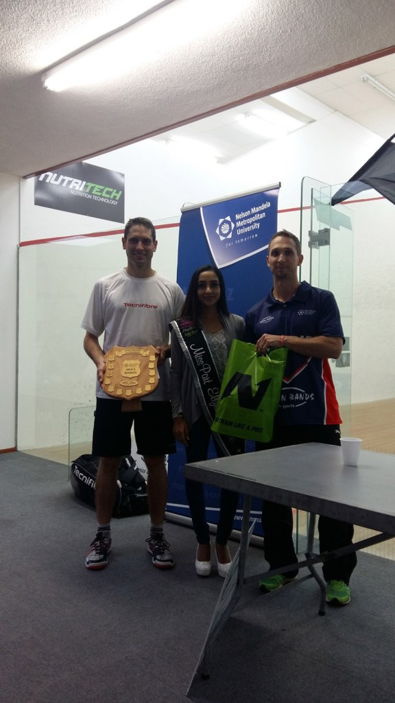 CAPTION: Cape Town's Gary Wheadon (left) won his fifth Madibaz Open squash title at the weekend. With him are Miss Port Elizabeth Nureen Hoosein, also an NMMU squash player, and tournament director Jason le Roux. Photo: Supplied